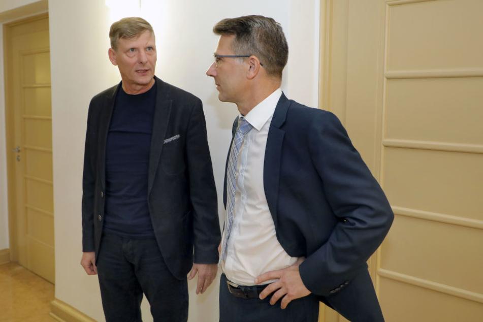 Uwe Bauch und Andreas Georgi haben gewonnen, die Hausverbote gegen sie bleiben erstmal außer Kraft.