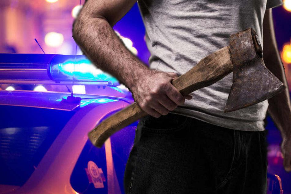 Mann stellt Auto quer auf die Straße und bedroht anderen Fahrer mit Axt