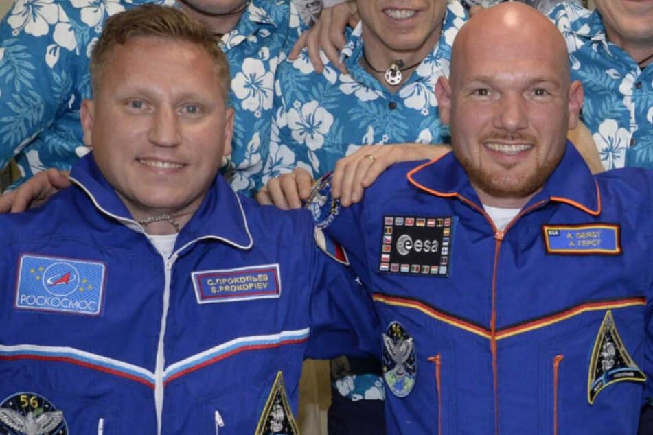 Der russische Kosmonaut Sergej Prokopjew und der deutsche Astronaut Alexander Gerst.