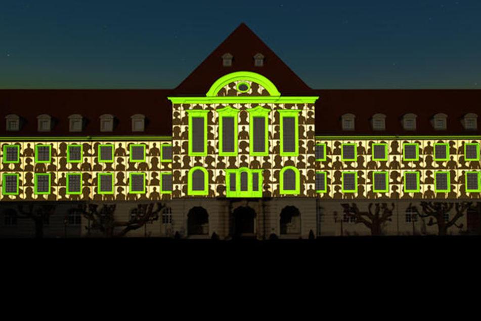 Noch zieren Silhouetten als Platzhalter das Rathaus. Ab dem 7. Februar werden hier Fotos von Bürgerinnen und Bürgern projiziert.