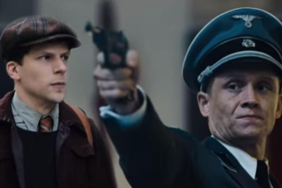 Ungewöhnliche Kombi in spannendem Setting: Jesse Eisenberg (l.) schließt sich dem französischen Widerstand gegen Matthias Schweighöfer an.