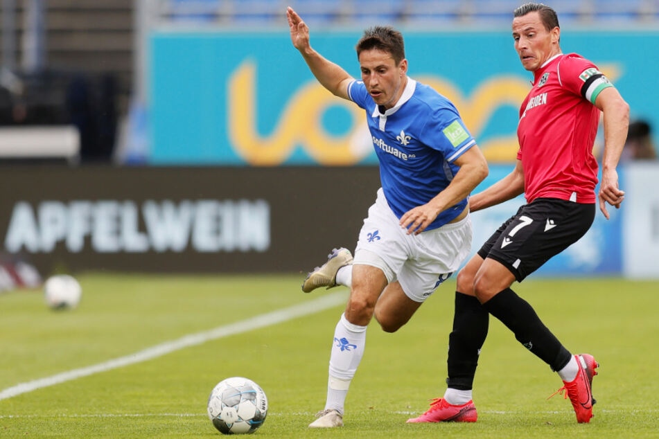 Zwei Ausgleichstorschützen im Duell: Fabian Schnellhardt (l.) erzielte für die Lilien das 2:2, 96-Kapitän Edgar Prib hatte zum 1:1 getroffen.