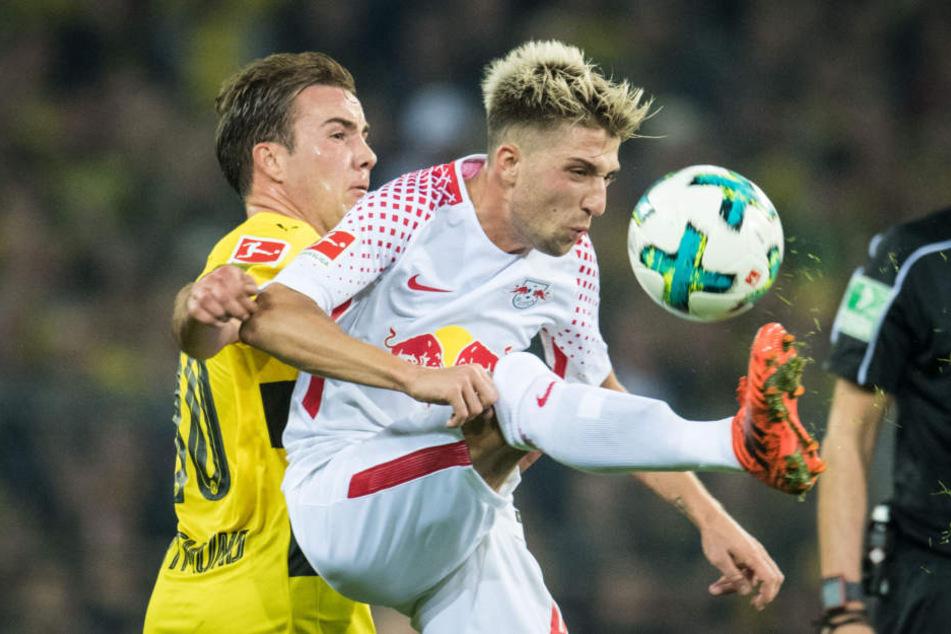 Duellieren sich nach dem 3:2-Hinrundensieg diesmal in Leipzig: Dortmunds Mario Götze (l.) und Kevin Kampl.