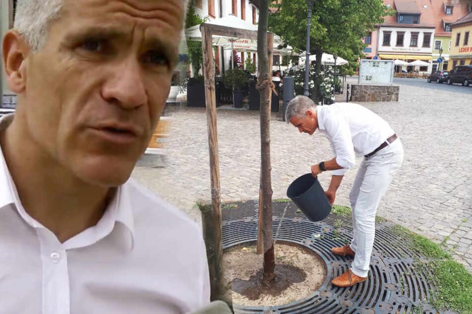"""Oberbürgermeister Matthias Berger (50) legt selbst Hand an und ruft zur """"Baum-Gieß-Challenge"""" auf."""