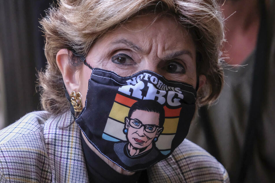 Attorney Gloria Allred, who represents several of Harvey Weinstein's accusers, wore a RBG face mask on Wednesday as she spoke outside the court following Harvey Weinstein's not guilty plea in Los Angeles.
