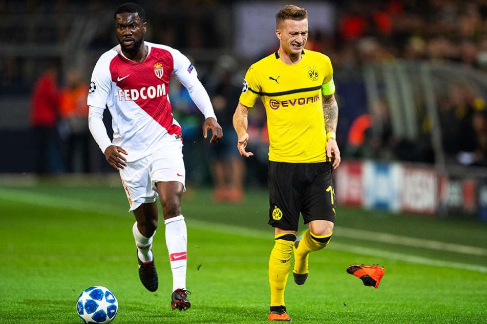 Ups! BVB-Star Marco Reus (r.) verliert seinen Schuh, nachdem er von Monacos Jean-Eudes Aholou (l.) hart - aber fair - attackiert wurde.