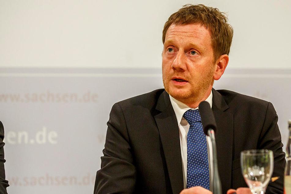 Ministerpräsident Michael Kretschmer will am Wochenende den Sachsenring besuchen und ein Signal setzen.