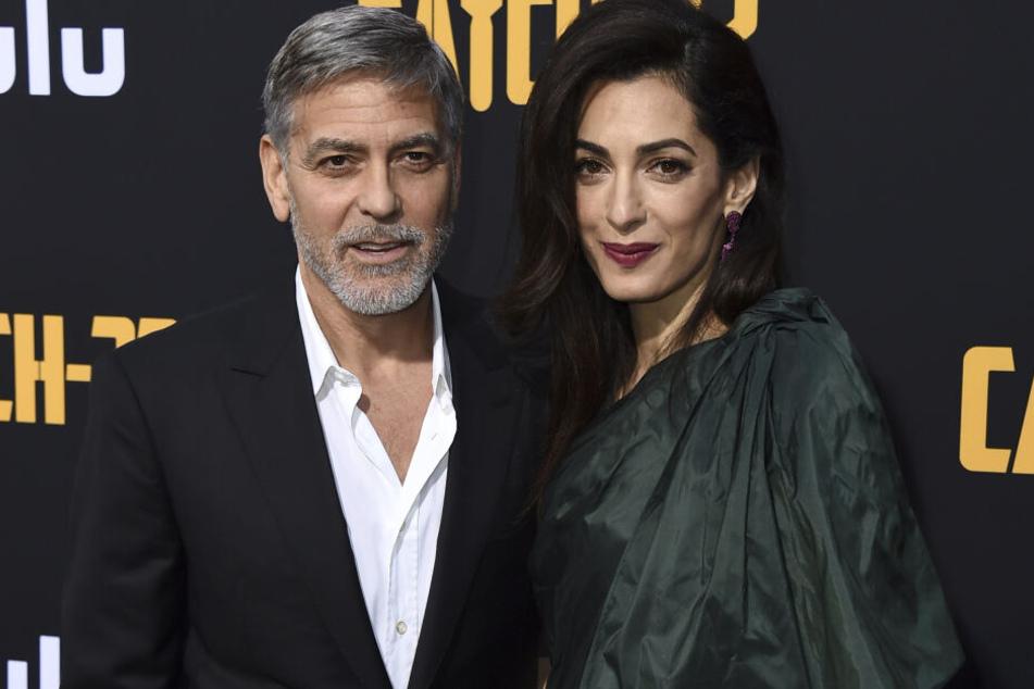 George (58) und Amal Clooney (42) gehören auch zu den Opfern von Sturm Dennis.