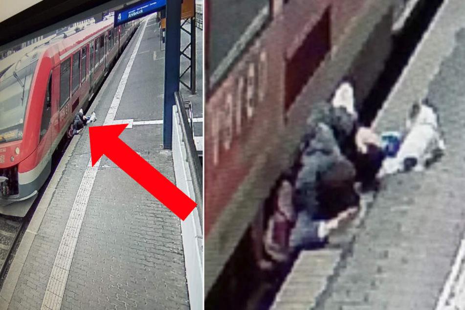 Mann mit Hund im Arm will verpassten Zug anhalten, doch das ist keine gute Idee!