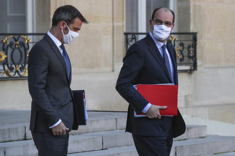 Olivier Veran (l), Gesundheitsminister von Frankreich, und Jean Castex, Premierminister von Frankreich.