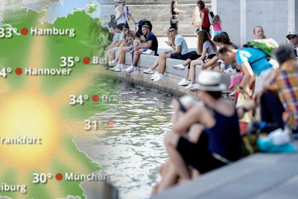 Menschen sitzen im Regierungsviertel im Schatten des Paul-Löbe-Hauses bei warmen Temperaturen am Spreeufer.