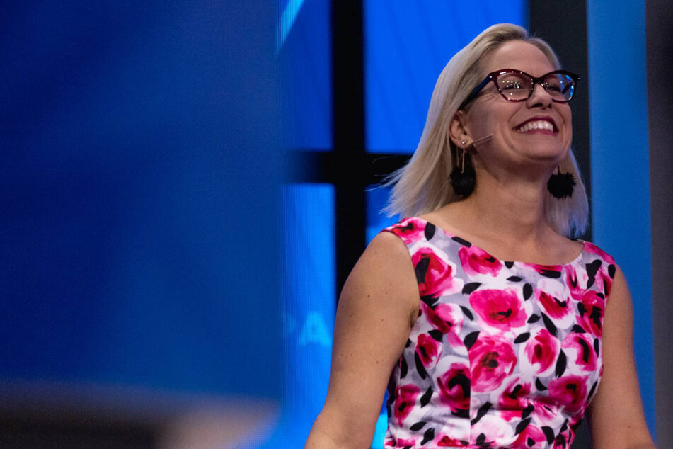 Kyrsten Sinema jets off to Europe as reconciliation negotiations continue