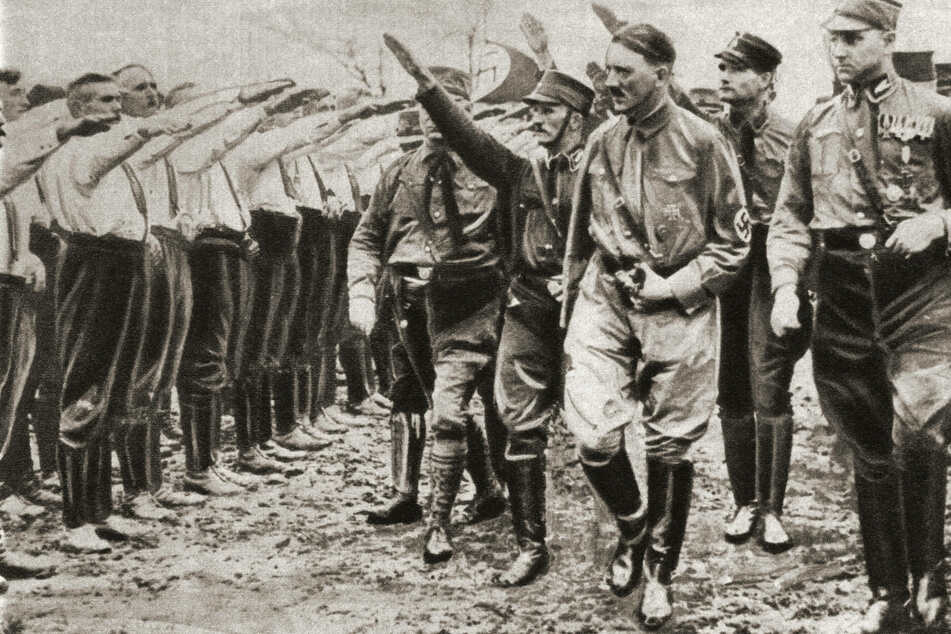 Adolf Hitler inspects members of the Nazi Party in 1930 (archive image).
