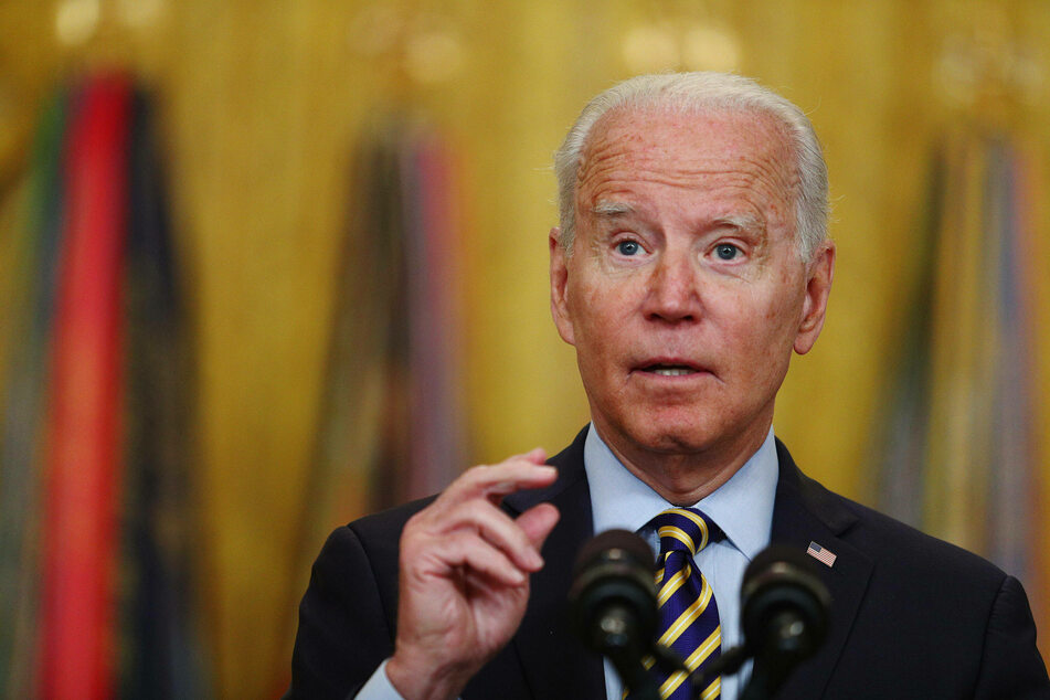 Biden gives deadline for US withdrawal from Afghanistan as clashes with Taliban continue