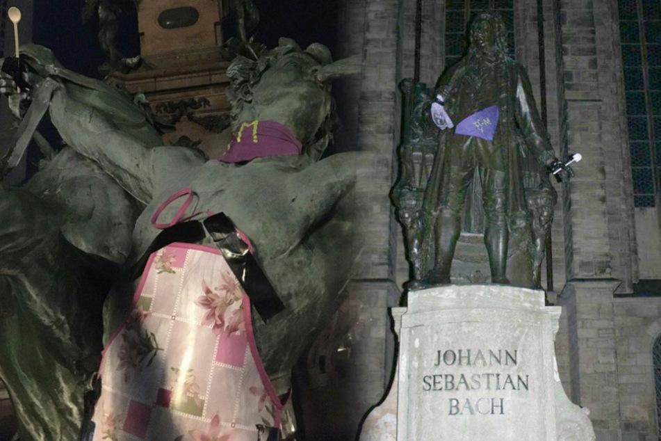 Leipzig: Statuen mit Kochlöffel und Kittelschürze? Deshalb hält Bach eine Klobürste