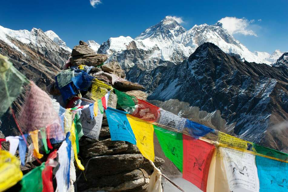 Flags on the top of Mount Everest (stock image).