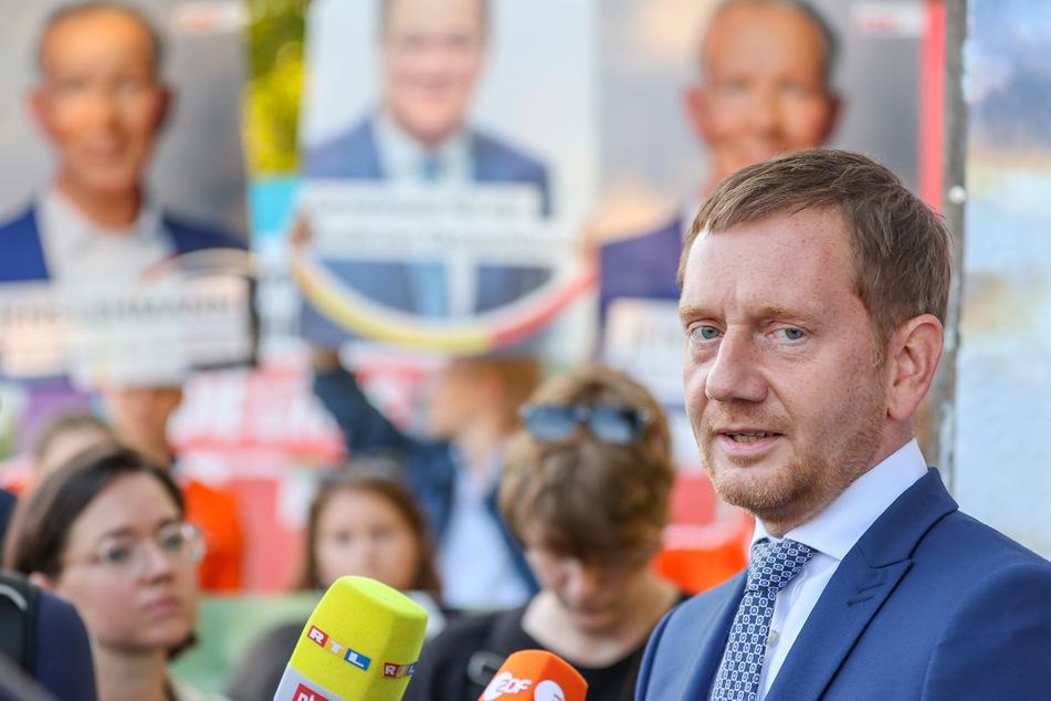 Zum Endspurt im Wahlkampf besuchte Sachsens Ministerpräsident Michael Kretschmer (46, CDU) am Freitag die Stadt Taucha und berichtete von einer Morddrohung, die er erhalten hat.