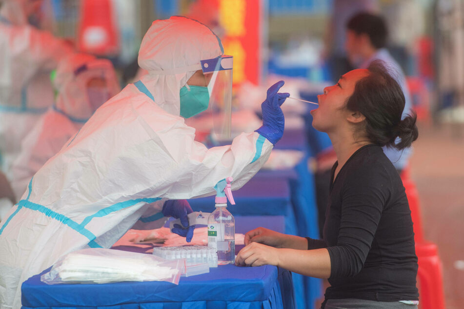 A resident takes a nucleic acid test in the Dongxihu District in Wuhan.