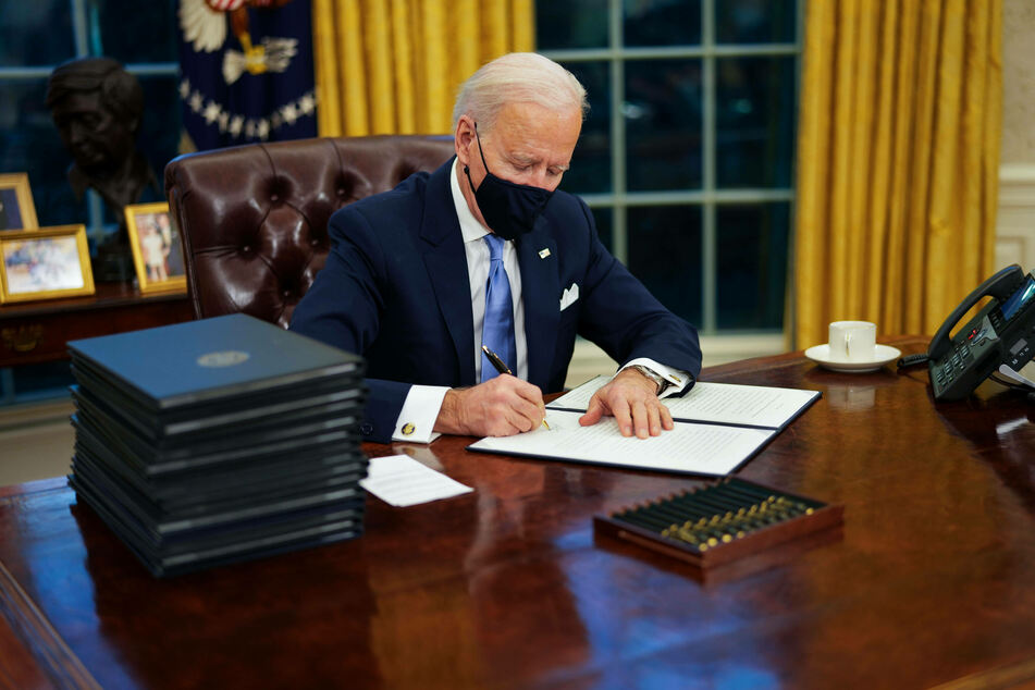 Joe Biden signed a series of executive orders on his first day in the Oval Office.