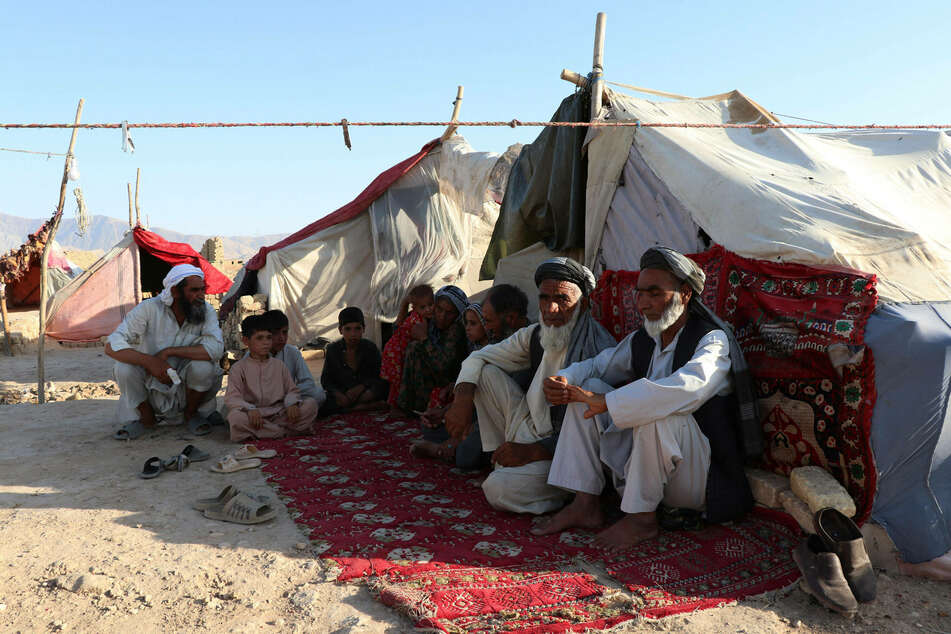 Afghan citizens are seen at a displaced persons camp in Mazar-i-Sharif as fighting has intensified since the start of US troop withdrawal.