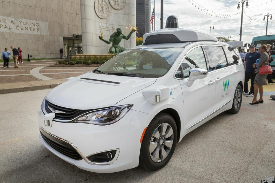 A Waymo self-driving car on display at the Detroit Moves Mobility Festival.