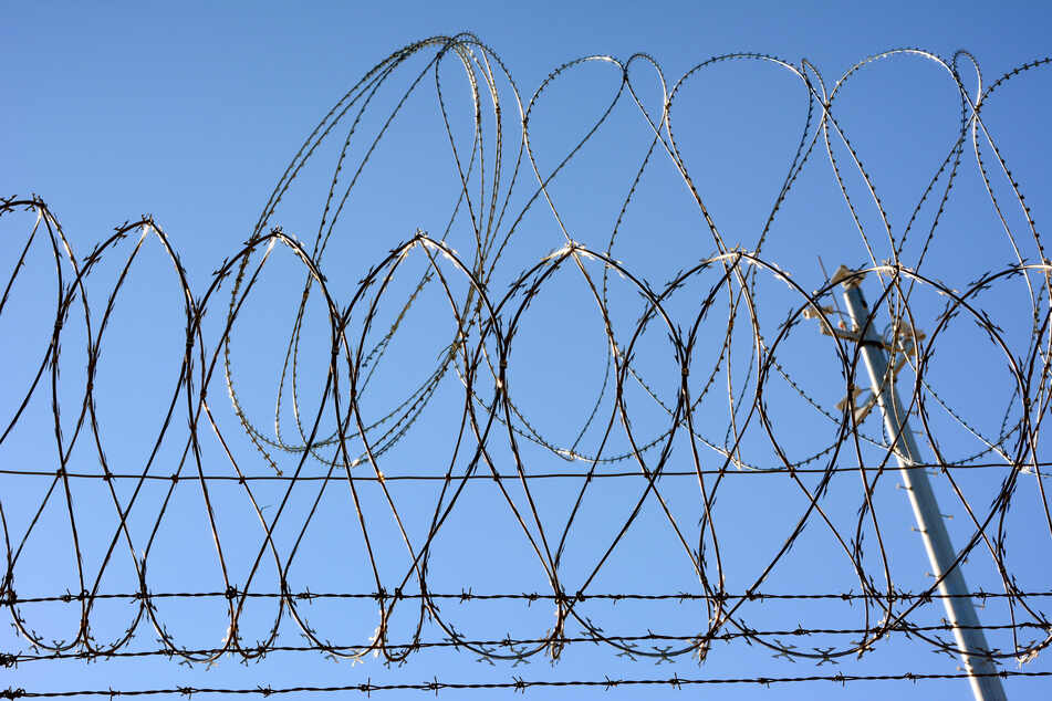 Barbed wire on US-Mexican border fence. Every month thousands of people try to get from Mexico to the USA.