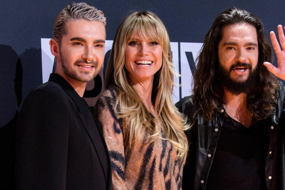 """Bill (31, l.) und Tom Kaulitz (31) kommen gemeinsam mit Heidi Klum (47) zur Verleihung der """"About you""""-Awards 2019. Am Montag waren die Kaulitz-Zwillinge mit ihrer Band """"Tokio Hotel"""" zu Gast bei """"Late Night Berlin"""". Im Publikum saß Edel-Fan Heidi."""