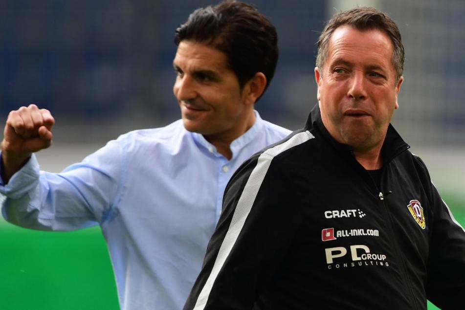 Dynamo-Coach Markus Kauczinski (rechts) war angefressen, sein 96-Kollege Kenan Kocak ballte dagegen die Siegerfaust.