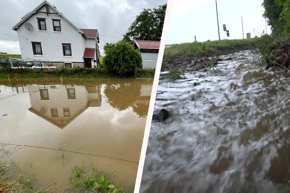 Feuerwehren im Dauereinsatz: Heftige Regengüsse setzen Keller unter Wasser, Bäche treten über Ufer