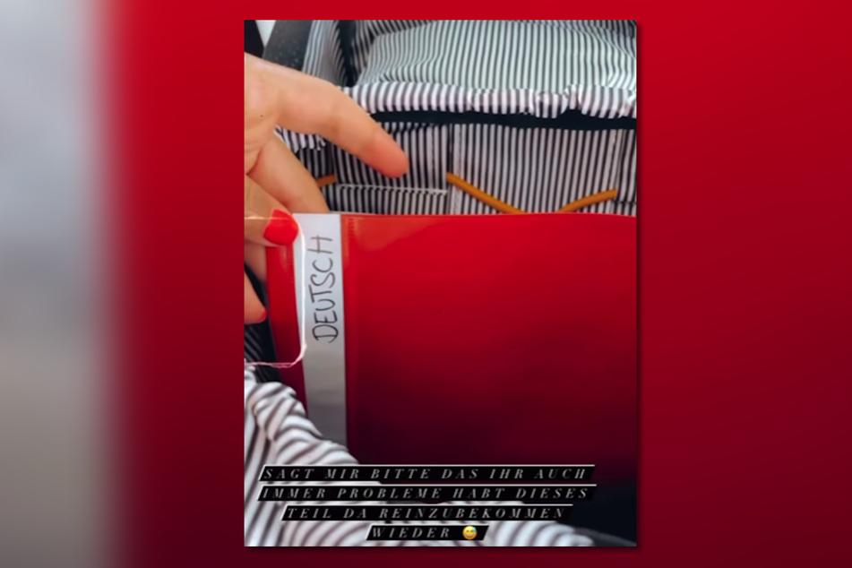 Ein roter Hefter für das Fach Deutsch ließ die junge Mutter verzweifeln: Die weiße Papier-Lasche wollte beinahe nicht mehr in den Ordner zurück.