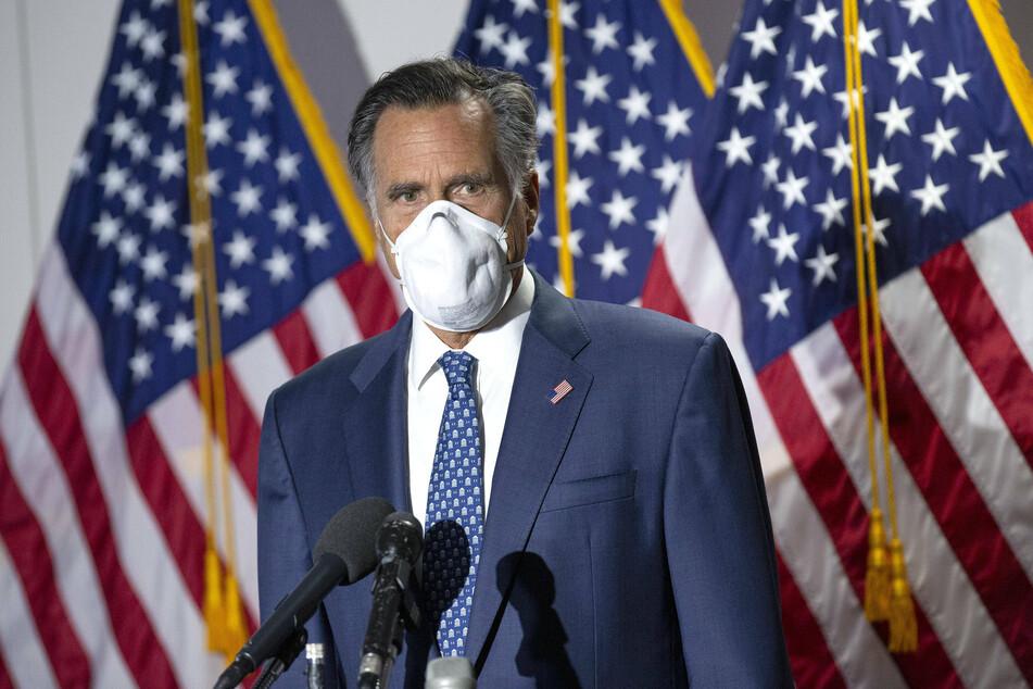 Senator Mitt Romney wearing a mask while speaking to reporters in Washington.