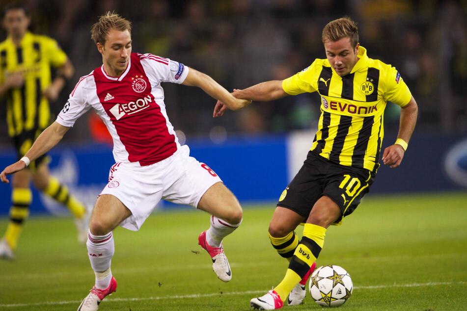 Christian Eriksen (l.) erwischte in der Saison 2012/13 mit Ajax eine echte Krachergruppe! Auch der spätere Finalist Borussia Dortmund um den WM-Siegtorschützen von 2014, Mario Götze (29), war einer der Gegner.