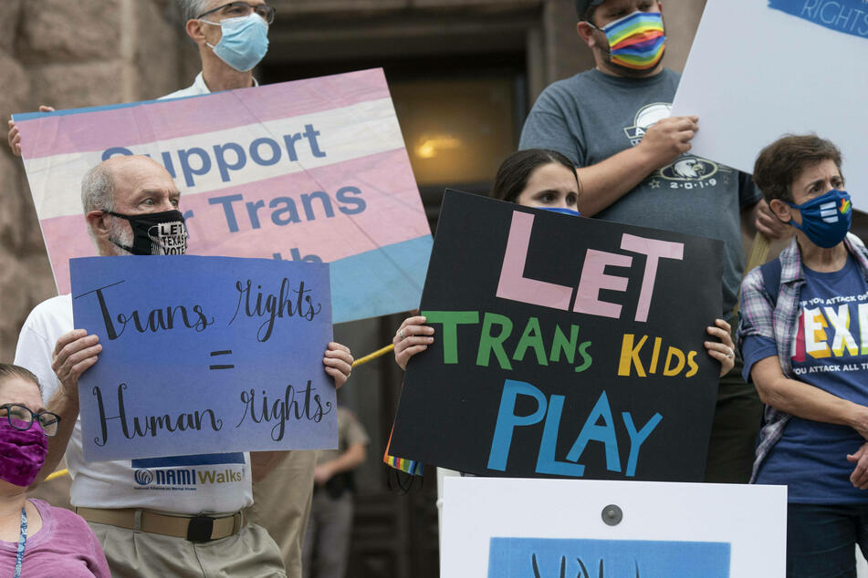 LGBTQ+ activists protested the Texas legislature's attempts to limit transgender rights.