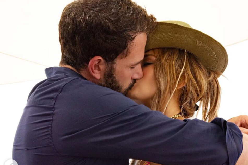 Ben Affleck and Jennifer Lopez share a passionate kiss on J. Lo's 52nd birthday.