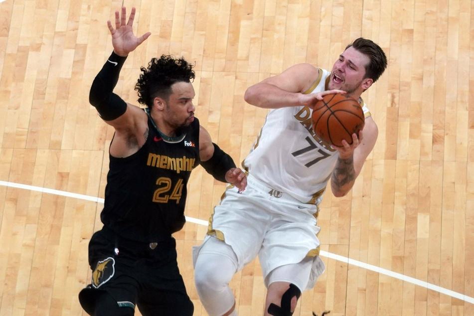 Dallas Mavericks Luka Doncic tries to shoot past Memphis Grizzlies Dillon Brooks