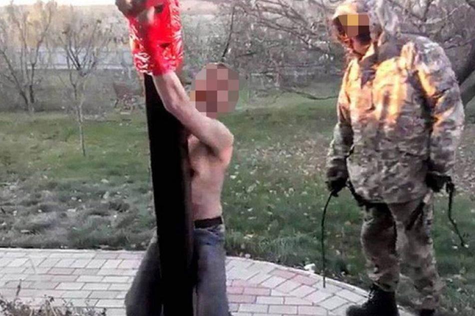 Prorussische Rebellen peitschen Opfer mit Kabel aus