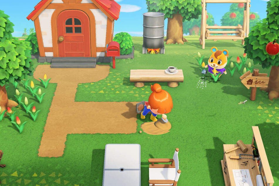 A player maintaining their garden in Animal Crossing: New Horizons.
