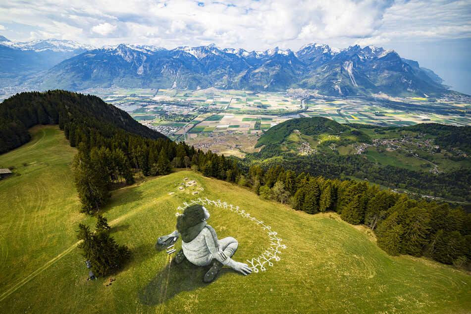 Nach der Coronavirus-Krise sollen alle Menschen gemeinsam in die gleiche Richtung blicken, sagt der Künstler mit diesem Bild.