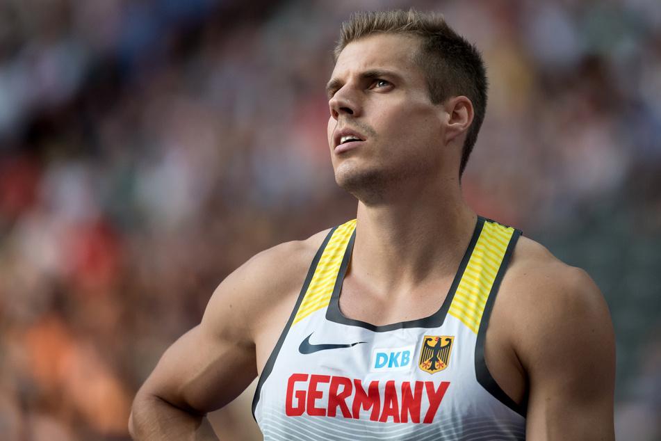 Julian Reus nach einem 100m Sprint im Berliner Olympiastadion im Ziel.