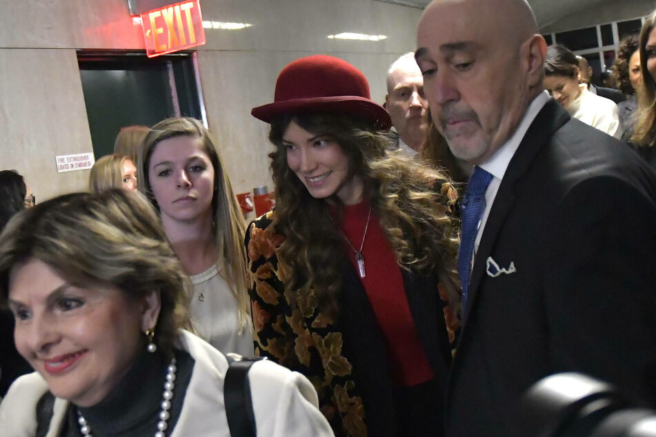 Actor and victim of Harvey Weinstein Lauren Young (c.) exits the courtroom at Manhattan in March 2020.