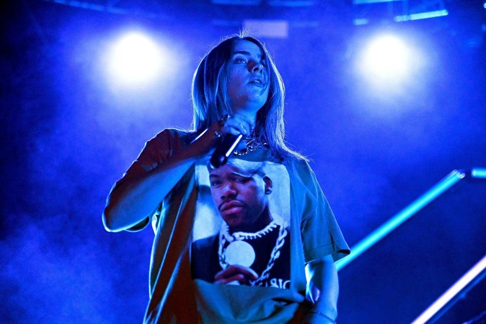 World star Billie Eilish performing on stage.