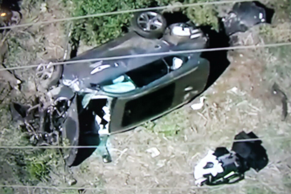 Tiger Woods' SUV crashed into a median and rolled over. The golf star had to be extricated through the windshield.