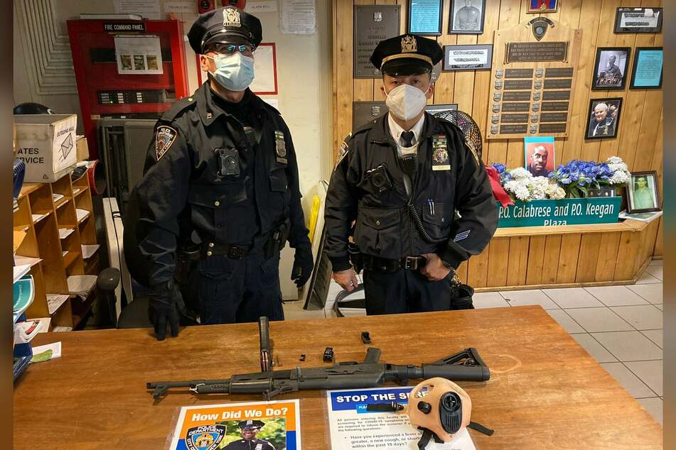 NYPD officers posing with the weapon seized from Saadiq Teague.