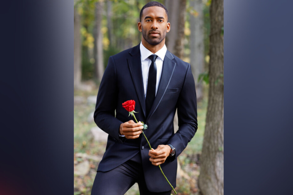 Photo of The Bachelor's Matt James holding a rose.