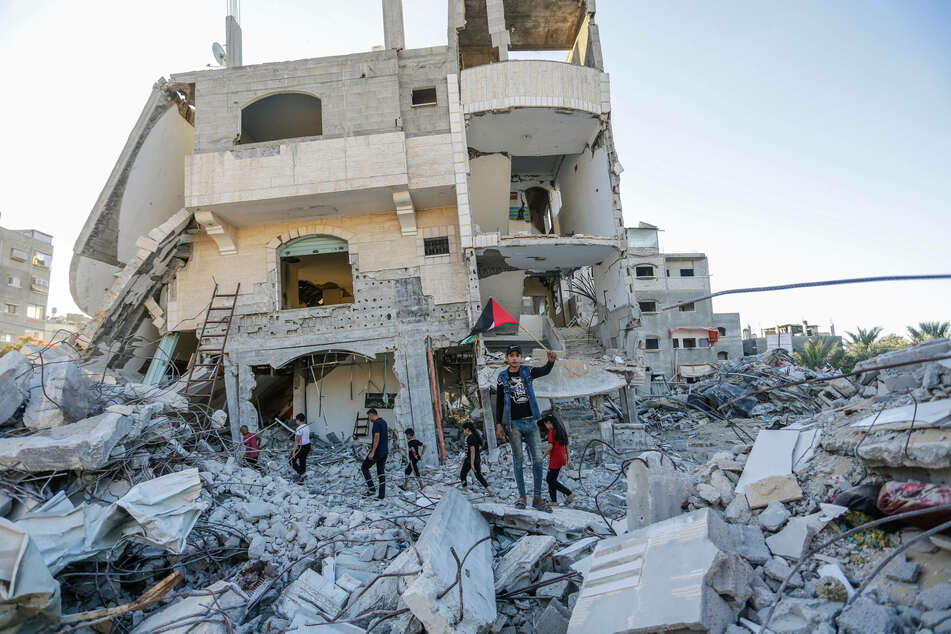Israeli airstrikes hit Gaza after Palestinians protested the nationalist Flag March celebrating the occupation of East Jerusalem.