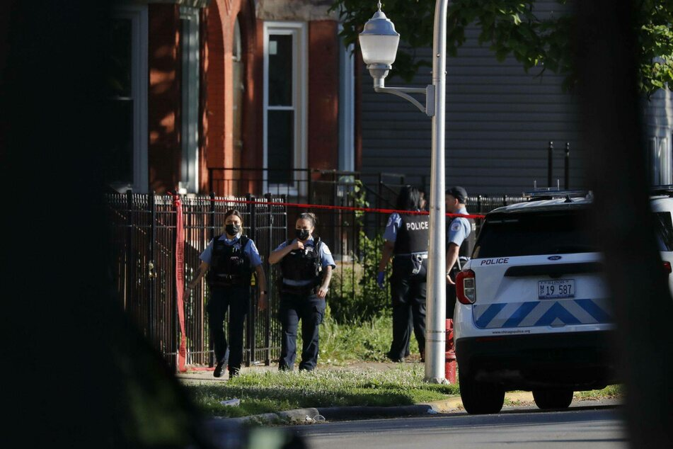 Police work at the scene of a mass shooting in Chicago's Englewood neighborhood.
