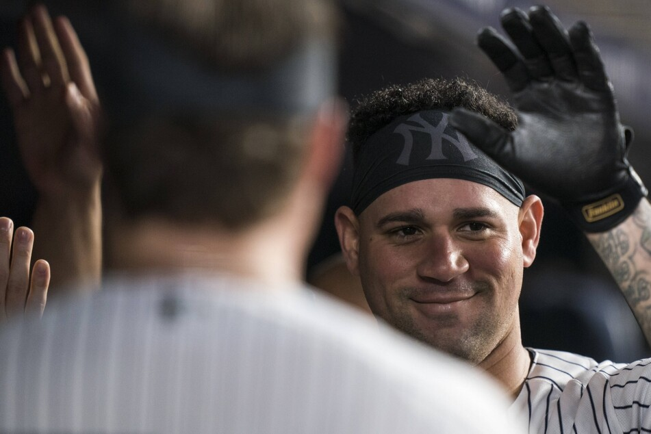 MLB: The Yankees keep their playoff hopes hanging by a thread after outlasting the Rangers