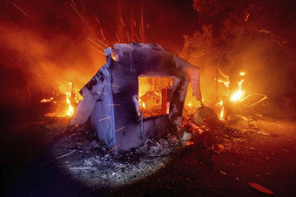 A house was engulfed by the flames and was destroyed.