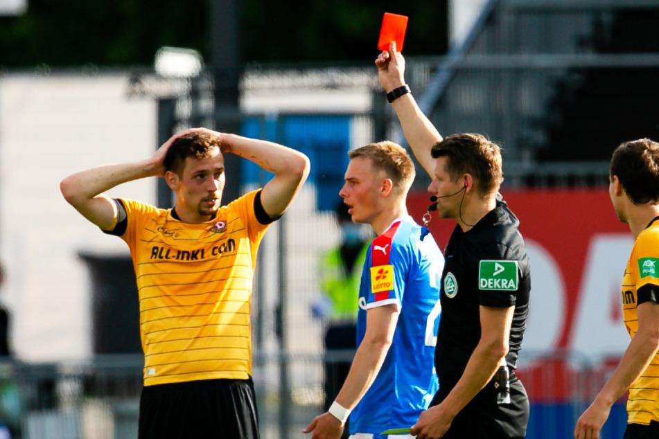 Jannik Müller (l.) erwies Dynamo in Kiel einen Bärendienst und sah noch vor der Pause die Gelb-Rote Karte.