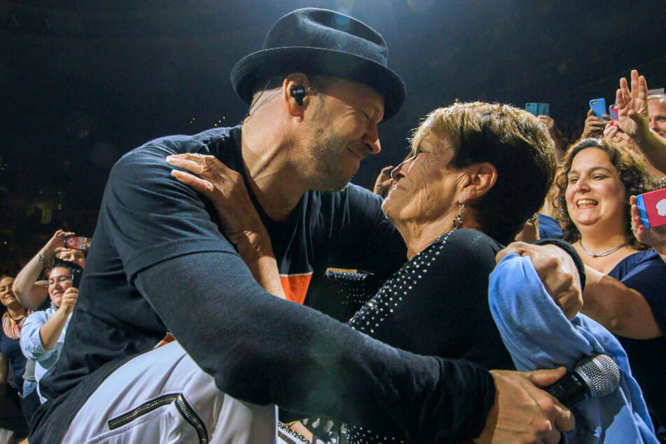 Donnie hugged his mother Alma at a concert in 2010.